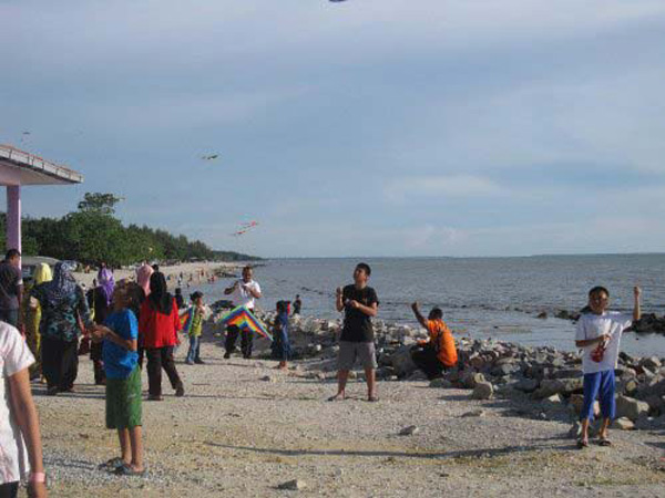 Children is flying kites at Pantai Remis Kuala Selangor